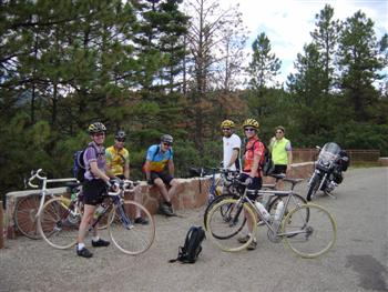 Cyclists at crest of US Hill in New Mexico